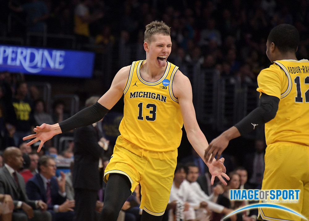 Michigan Wolverines forward Moritz Wagner (13) celebrates with guard Muhammad-Ali Abdur-Rahkman (12) in the first half against the Texas A&M Aggies during a West Regional semifinal of the NCAA men's college basketball tournament, Thursday, March 22, 2018, in Los Angeles. Michigan defeated Texas A&M 99-72.
