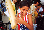 MARCH 19, 2001 - HAVANA, CUBA: A girl picks up a ration of bread at a government bakery in the Regla neighborhood of Havana, Cuba, March 19, 2001. Regla is across the harbor from the rest of the city and is the center of the Santeria religion in Cuba. It is also home to many of Havana's oil refineries and heavy industries. Many staples, including bread, are still rationed by the Cuban government.  PHOTO BY  JACK KURTZ     LABOUR  LABOR  UNEMPLOYMENT  ECONOMY  FOOD POVERTY  CHILDREN