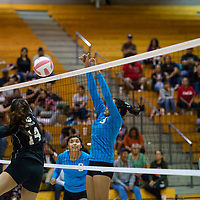 Hailey Martin, #3, blocks a spike by Mikayla Bowie, #14, at the net Wednesday night at Gallup High School in Gallup.