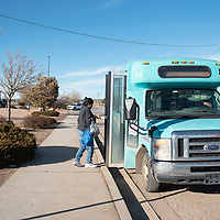 The Gallup Express picks up riders at their Wal-Mart bus stop Tuesday afternoon in Gallup. Gallup Express was awarded the New Mexico Rural Transit System of the Year for 2018.