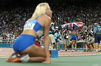 23/08/04 - ATHENS  - GREECE -  - Woman 800Mts. FINAL   -  Olympic Stadium - <br />British N* 1809 HOLMES KELLY win the gold medal by time that 3010 CEPLAKÊ Jolanda wait for the tv anuncement.<br />© Gabriel Piko / Argenpress.com / Piko-Press<br /> NORWAY ONLY
