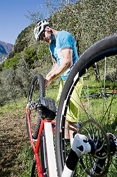 Man repairing flat type on electic-mountainbike