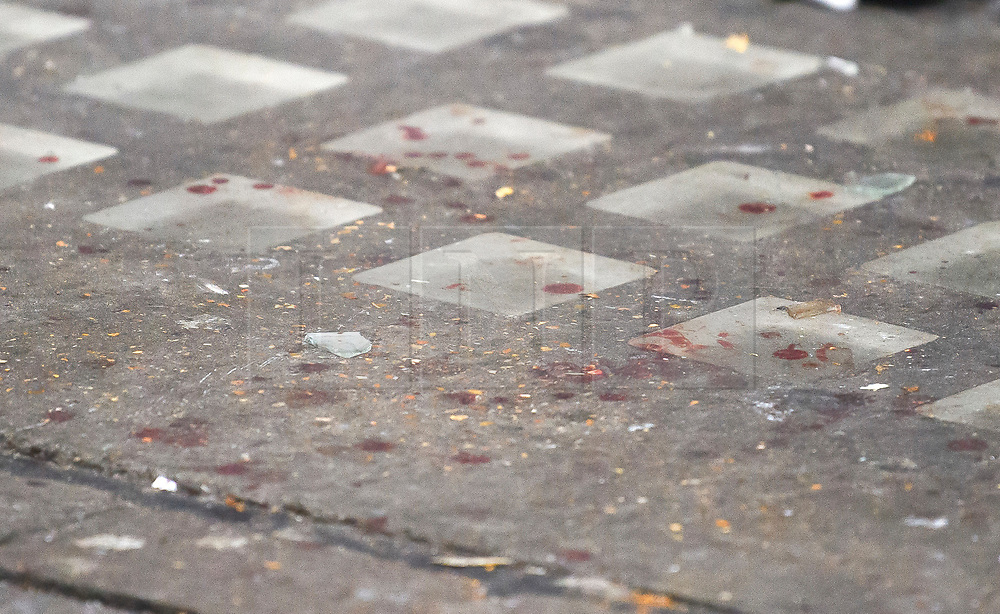 © Licensed to London News Pictures. 03/01/2019. London, UK. Blood stains on the pavement outside the entrance doorway to 80 Park Lane in Mayfair, where security guard Tudor Simionov was stabbed to death in the early hours of New Year's day. The 33-year-old and his colleagues were attacked by a group of men who were trying to gain entry to a party at Fountain House, a £12.5 million townhouse in London's West End.. Photo credit: Ben Cawthra/LNP