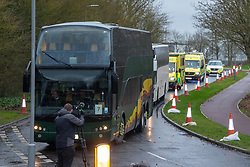 © Licensed to London News Pictures. 09/02/2020. Milton Keynes, UK. Coaches carrying British evacuees from China arrive at Kents Hill Park Training and Conference Centre. A Milton Keynes conference centre is to house evacuees from the Chinese city of Wuhan, the epicentre of the Novel Coronavirus (2019-nCoV) outbreak, the British citizens arrived back on Sunday 9th February and landed at RAF Brize Norton in Oxfordshire and will remain at the conference centre for 14 days to be monitored. Photo credit: Peter Manning/LNP