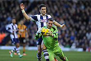 Hull city goalkeeper Alan McGregor saves from WBA's Shane Long. Barclays Premier league, West Bromwich Albion v Hull city at the Hawthorns in West Bromwich, England on Saturday 21st Dec 2013. pic by Andrew Orchard, Andrew Orchard sports photography.