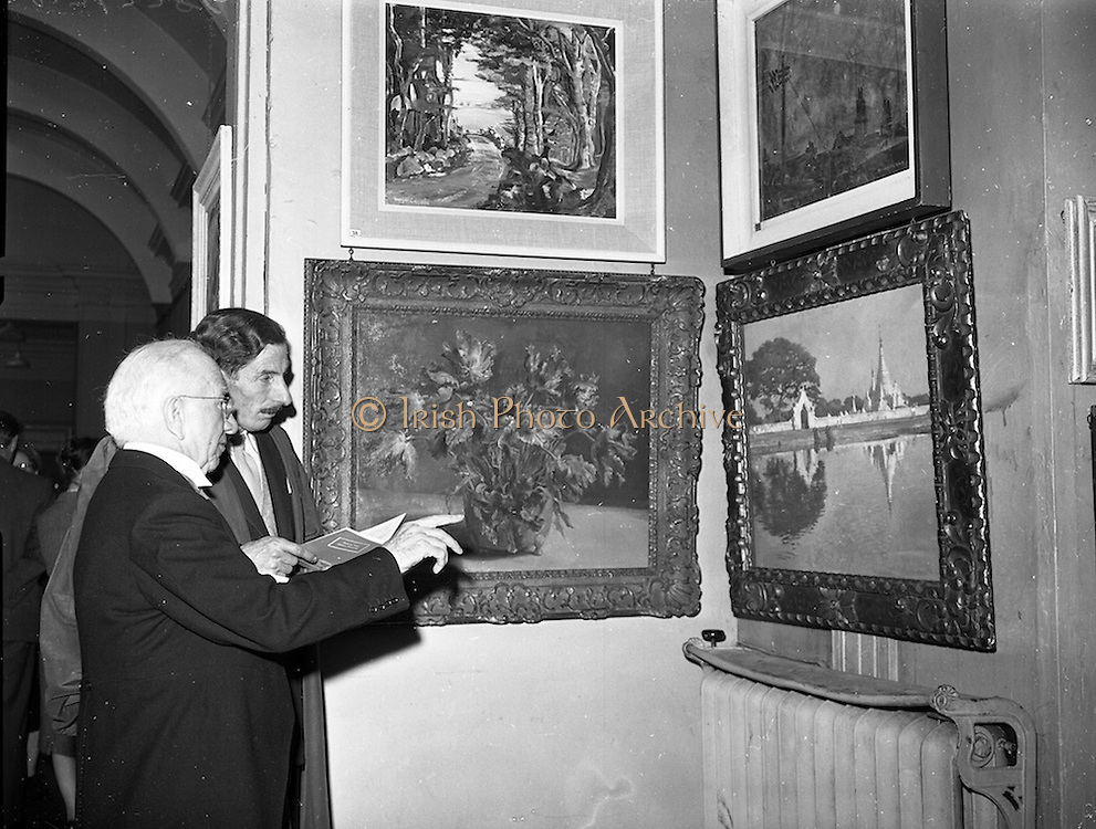 27/04/1959<br /> 04/29/1959<br /> 27 April 1959<br /> Opening day of the R.H.A. Exhibition at the Royal Hibernian Academy, Dublin. The President Sean T. O'Kelly viewing part of the exhibition with Micheal de Burca, Secretary.