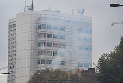 © Licensed to London News Pictures. 14/11/2017. London, UK. Smoke is seen rising from a tower block near Edgeware Road tube. The area filled with acrid smelling smoke until the Fire Brigade arrived.Photo credit: Peter Macdiarmid/LNP