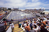 2000: Overview of crowd and rink. Roller hockey player skating action during Pro Beach Hockey PBH game in Huntington Beach southside of the Pier.   Southern California summer sport. Transparency slide scan.