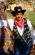 Cowgirl age 72 dressed up for inner city youth rodeo fundraiser.  St Paul  Minnesota USA
