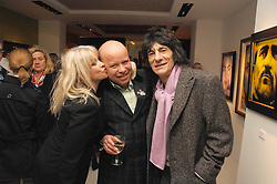 Left to right, JO WOOD, PAUL KARSLAKE and RONNIE WOOD at an exhibition of artist Paul Karslake's work entitled Ideas & Idols, held at Scream, 34 Bruton Street, London W1 on 21st February 2008.<br /><br />NON EXCLUSIVE - WORLD RIGHTS