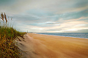 A beach on the North Carolina coast, nearby Cape Lookout Lighthouse