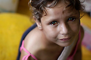 Ludmila Moura, 5, who was pulled out of her destroyed house by her father Marcelo, sits on a mattress at a shelter for people displaced by landslides in Nova Friburgo, Brazil, Sunday, Jan. 16, 2011. <br /> <br /> A series of flash floods and mudslides struck several cities in Rio de Janeiro State, destroying houses, roads and more. More than 900 people are reported to have been killed and over 300 remain missing in this, Brazil's worst-ever natural disaster.
