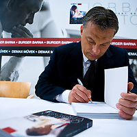 Viktor Orban signs the book during the official premier of the photo book by Barna Burger covering the victorious election campaign of Hungarian opposition leader Viktor Orban that led him to becoming prime minister. Budapest, Hungary. Thursday, 29. April 2010. ATTILA VOLGYI