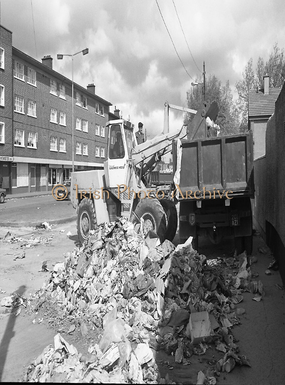 Army Removes Refuse In Dublin..1986..05.06.1986..06.05.1986..5th June 1986..Due to the ongoing strike by Dublin Corporation workers,the army were called in to help clear some of the mounds of rubbish stacking up around the city. Health worries from the rotting rubbish and the danger of rat infestation caused the intervention. The 2nd Garrison Supply and Transport Company,McKee Barracks,Dublin were delegated to clear the rubbish from St Theresa's Flats,Donore Avenue,Dublin...Picture shows soldiers operating the bulldozer to clear some of the rubbish building up around the city. Army vehicles had to be used as the corporation vehicles were under picket.