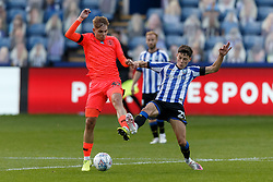 Emile Smith Rowe of Huddersfield Town and Alex Hunt of Sheffield Wednesday - Mandatory by-line: Daniel Chesterton/JMP - 24/06/2020 - FOOTBALL - Hillsborough - Sheffield, England - Sheffield Wednesday v Huddersfield Town - Sky Bet Championship