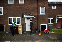© Licensed to London News Pictures . 11/09/2020. Bolton , UK . PCs TONY LOWE and TERRY WILKINSON investigate after a report , believed to be false , that people were gathered in breach of Coronavirus prevention regulations , in the garden of a house in Westhoughton . Police officers from Greater Manchester Police and Environmental Health Officers from Bolton Council respond to concerns of breaches of Coronavirus regulations , as stricter lockdown measures and a curfew on hospitality businesses are imposed in the borough to limit the spread of Covid-19 . Photo credit : Joel Goodman/LNP