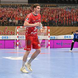 Ludwigshafens Hendrik Wagner (Nr.28) mit dem Ball beim Spiel in der Handball Bundesliga, Die Eulen Ludwigshafen - THW Kiel.<br /> <br /> Foto © PIX-Sportfotos *** Foto ist honorarpflichtig! *** Auf Anfrage in hoeherer Qualitaet/Aufloesung. Belegexemplar erbeten. Veroeffentlichung ausschliesslich fuer journalistisch-publizistische Zwecke. For editorial use only.