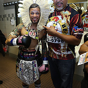 """Orlando """"El Fenomeno""""  Cruz (L) poses with his outfit on prior to his match against  Gabino """"Flash"""" Cota during the Boxeo Telemundo WBO/NABO Super Featherweight bout on Friday, October 9, 2015 at the Kissimmee Civic Center in Kissimmee, Florida. Cruz, who is from Puerto Rico, is the first ever openly gay boxer  in the history of the sport and won the bout by unanimous decision.  (Alex Menendez via AP)"""