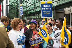 London, UK. 15 July, 2019. Fran Heathcote, President of the PCS trade union, talks to catering and cleaning staff outsourced to work at the Department for Business, Energy and Industrial Strategy (BEIS) via contractors ISS World and Aramark on the picket line outside the Government department after walking out on an indefinite strike for the London Living Wage, terms and conditions comparable to the civil servants they work alongside and an end to outsourcing.