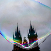 The towers of Teyn Church at Old Town Square in Prague behind a bubble made by a street artist. #prag #praha #prague #oldtownsquare #teynchurch #czechrepublic #latergram #bubble #street #streetart #tower #colors #light #tschechien