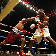 J'Leon Love (red trunks) beats Vladine Biosse during Showtime Televisions ShoBox:The Next Generation boxing match at the Event Center at Turning Stone Resort Casino on Friday, February 28, 2014 in Verona, New York.  (AP Photo/Alex Menendez)