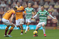 Callum McGregor (Celtic) goes past Stephen O'Donnell (Motherwell) during the Scottish Premiership match between Motherwell and Celtic at Fir Park, Motherwell, Scotland on 8 November 2020.
