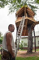Builder Bob Cosco has made many trips up and down this ladder as he has single handedly built this Tree House on Riverside Court in Laconia.  (Karen Bobotas/for the Laconia Daily Sun)