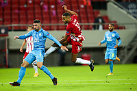 PIRAEUS, GREECE - OCTOBER 21: Youssef El-Arabi of Olympiacos FC and Álvaro of Olympique de Marseille during the UEFA Champions League Group C stage match between Olympiacos FC and Olympique de Marseille at Karaiskakis Stadium on October 21, 2020 in Piraeus, Greece. (Photo by MB Media)