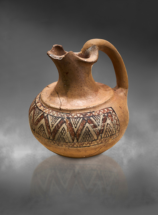 Phrygian terracotta trefoil jug decorated with geometric designs . 8th-7th century BC . Çorum Archaeological Museum, Corum, Turkey .<br /> <br /> If you prefer to buy from our ALAMY PHOTO LIBRARY  Collection visit : https://www.alamy.com/portfolio/paul-williams-funkystock/phrygian-antiquities.html (TIP - Refine search by adding a suject or background colour as well).<br /> <br /> Visit our CLASSICAL WORLD HISTORIC SITES PHOTO COLLECTIONS for more photos to download or buy as wall art prints https://funkystock.photoshelter.com/gallery-collection/Classical-Era-Historic-Sites-Archaeological-Sites-Pictures-Images/C0000g4bSGiDL9rw