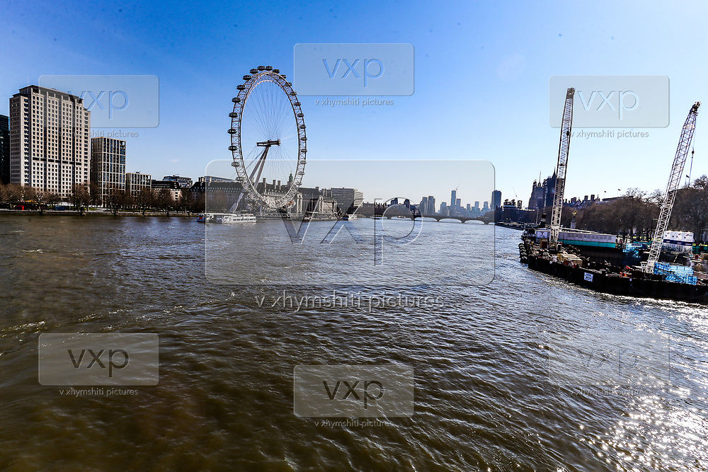 A general view of the city of London from the Golden Jubilee Bridge looking towards London Eye Wheel, Wednesday, March 25, 2020. British lawmakers voted to shut down Parliament for 4 weeks, due to the coronavirus outbreak. The new coronavirus causes mild or moderate symptoms for most people, but for some, especially older adults and people with existing health problems, it can cause more severe illness or death. (Photo/Vudi Xhymshiti)