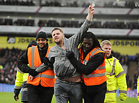 Football - 2017 / 2018 Premier League - Crystal Palace vs. Newcastle United<br /> <br /> A drunken fan is escorted off the pitch, at Selhurst Park.<br /> <br /> COLORSPORT/ANDREW COWIE