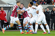 Aston Villa's Rudy Gestede (l) and Swansea's Ashley Williams (r) have to be separated after a challenge. Barclays Premier league match, Swansea city v Aston Villa at the Liberty Stadium in Swansea, South Wales on Saturday 19th March 2016.<br /> pic by  Carl Robertson, Andrew Orchard sports photography.