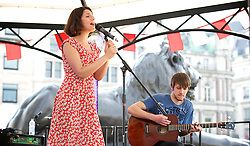 """Feast of St George 2014<br /> Trafalgar Square <br /> London <br /> United Kingdom<br /> 21st April 2014 <br /> <br /> <br /> Stella & """"The Shakes"""" perform on the bandstand stage in Trafalgar Square (formerly known as StaellaStar). They are current holders of the """"Mayor's Big Busk Gigs 2013 Groups category & of the Champion award. <br /> <br /> The band include Will Jackson (drums), Jack Gillen (pictured on guitar), Lyle Holloway (bass) and  Stella Charalambous, vocals. Their debut EP is called Blossom."""