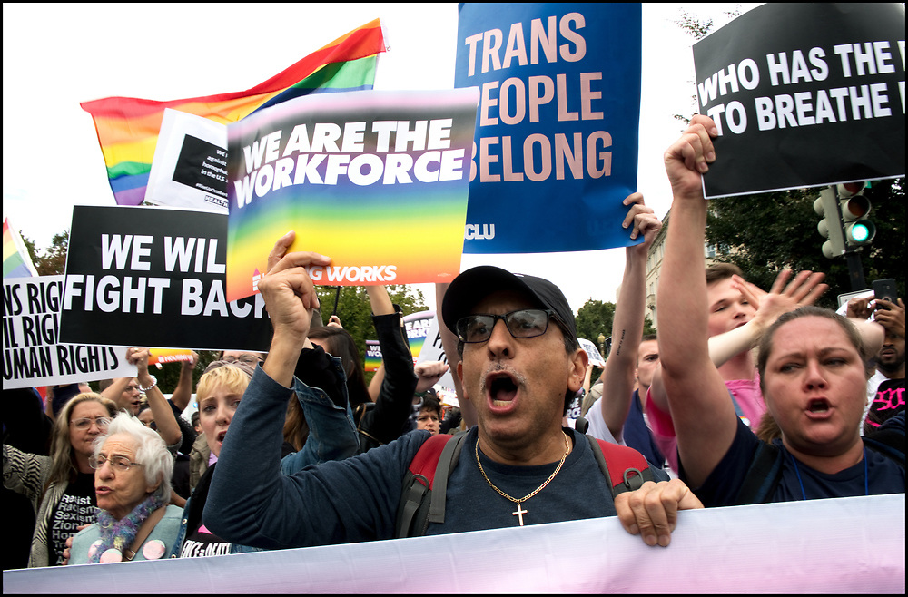 LGBTQ activists and supporters held a rally outside the U.S. Supreme Court as it heard arguments in a major LGBT rights case on whether a federal anti-discrimination law that prohibits workplace discrimination on the basis of sex covers gay and transgender employees in Washington, October 8, 2019. Over 100 activists who were affiliated with Housing Works and other organizations blocked First Street, N.E., in front of the court and were arrested.