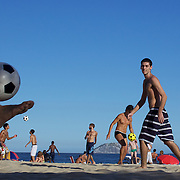 Locals practice foot volley, a hybrid game combining beach volley ball and football at Ipanema beach, Rio de Janeiro,  Brazil. 5th July 2010. Photo Tim Clayton..