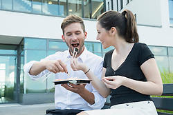 young couple eating Sushi at lunch time