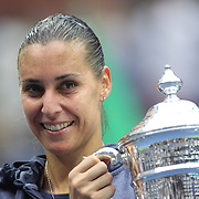 Flavia Pennetta, Italy, celebrates with the trophy after her victory against Roberta Vinci Italy, in the Women's Singles Final match during the US Open Tennis Tournament, Flushing, New York, USA. 12th September 2015. Photo Tim Clayton