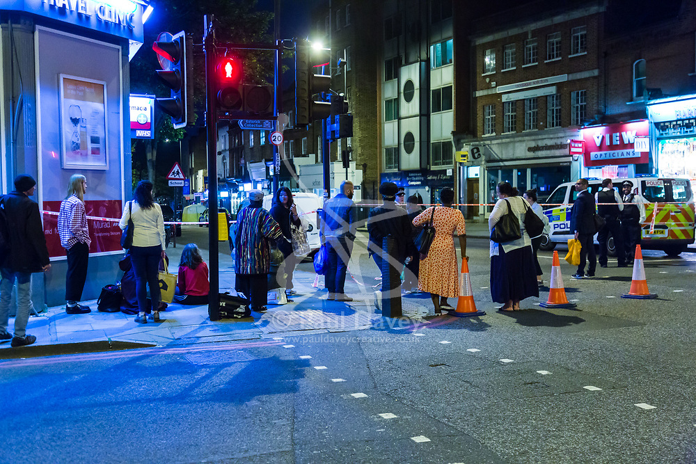Local residents are unable to return to their homes within the large cordon following a fatal stabbing of a man in broad daylight at around 6.30pm on Upper Street in Islington, North London. London, May 21 2018.