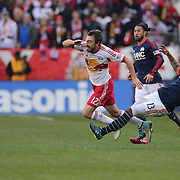 Eric Alexander, (left), New York Red Bulls, is fouled by Jermaine Jones, New England Revolution, during the New York Red Bulls Vs New England Revolution, MLS Eastern Conference Final, first leg at Red Bull Arena, Harrison, New Jersey. USA. 23rd November 2014. Photo Tim Clayton