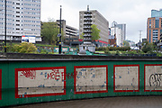 High rise housing estate tower blocks at the famous pagoda near the underpass at Holloway Circus in Birmingham city centre, which is virtually deserted under Coronavirus lockdown on a wet rainy afternoon on 28th April 2020 in Birmingham, England, United Kingdom. Britains second city has been in a state of redevelopment for some years now, but with many outdated architectural remnants still remaining, on a grey day, the urban landscape appears as if frozen in time. Coronavirus or Covid-19 is a new respiratory illness that has not previously been seen in humans. While much or Europe has been placed into lockdown, the UK government has put in place more stringent rules as part of their long term strategy, and in particular social distancing.