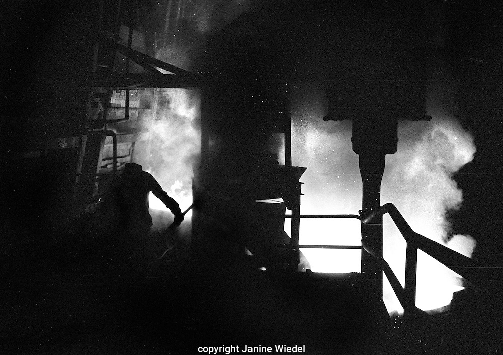Open Hearth Furnace during tapping.During this process the steel was collected in a ladle and other materials could be added directly to it to bring the steel to it's correct composition.<br /> Bilston Steelworks Open Hearth furnace in the Black Country West Midlands in the 1978