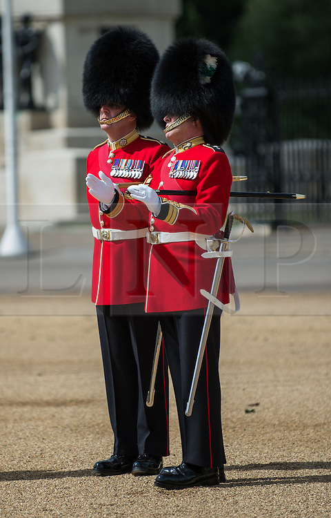 © London News Pictures. 30/05/2015. London, UK. Garrison Sergeant Major Billy Mott, goes through the fine details of the parade with his successor Sergeant Major Vern Stokes, who takes over the roll after the Queens Birthday Parade. The Major General's Review on Horse Guards Parade, London. 5,500 spectators filled the stands to witness the first of three annual world class military demonstrations that culminate with the Queen's Birthday Parade on 13th June. Photo credit: Sergeant Rupert Frere/LNP