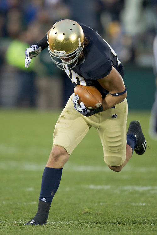 Notre Dame tight end Tyler Eifert (#80) makes catch of pass during first quarter of NCAA football game between Notre Dame and Boston College.  The Notre Dame Fighting Irish defeated the Boston College Eagles 16-14 in game at Notre Dame Stadium in South Bend, Indiana.
