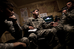 """Pilots and crew members go through a brief - discussing weather, threats, procedures for crash landings... - in Charlie Company headquarters before assuming their duties at the beginning of their shift. Scenes from the medical evacuations of wounded Americans, Canadians, and Afghan civilians and soldiers being flown by Charlie Co. 6th Battalion 101st Aviation Regiment of the 101st Airborne Division. Charlie Co. - which flies under the call-sign """"Shadow Dustoff"""" - flies into rush the wounded to medical care out of bases scattered across Oruzgan, Kandahar, and Helmand Provinces in the Afghan south. These images were taken of missions flown out of Kandahar Airfield in Kandahar Province and Camp Dwyer in Helmand Province."""