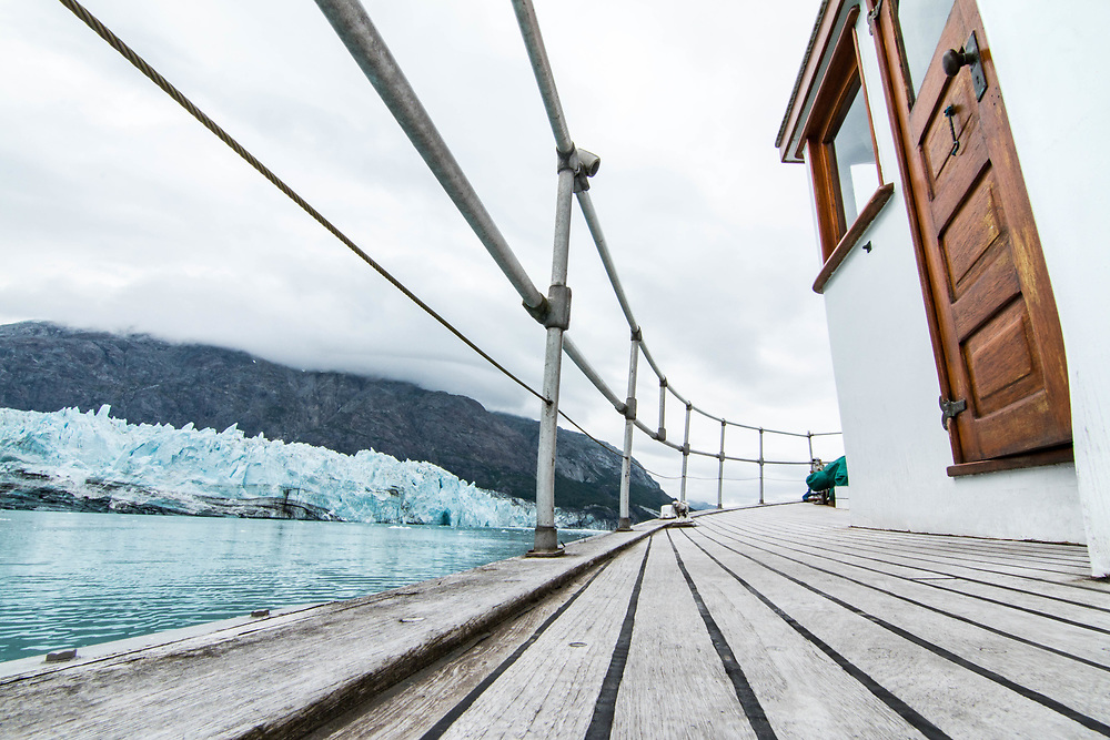 Classic lines of the old ship in the foreground with Marjorie Glacier.