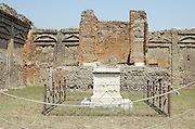 The ruins of the Altar at Aedes Genii Augusti aka Tempio di Vespasiano at Pompeii, Campania, Italy under the Vesuvius volcano, July 2006