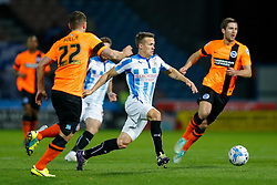 Jonathan Hogg of Huddersfield Town is challenged by Danny Holla of Brighton - Photo mandatory by-line: Rogan Thomson/JMP - 07966 386802 - 21/10/2014 - SPORT - FOOTBALL - Huddersfield, England - The John Smith's Stadium - Huddersfield Town v Brighton & Hove Albion - Sky Bet Championship.