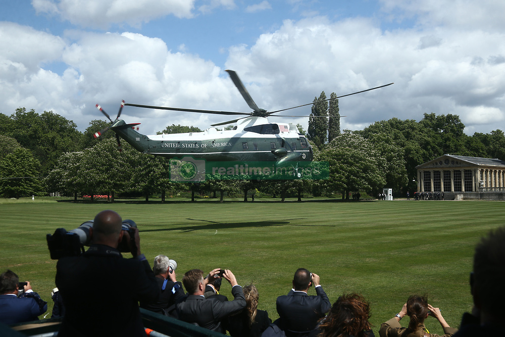 US President Donald Trump and his wife Melania arrive in Marine One at Buckingham Palace, in London on day one of his three day state visit to the UK.