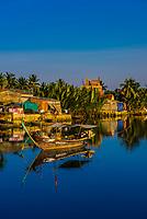 Fishing boats in a village along the Thu Bon River, near Hoi An, Vietnam.