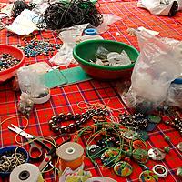 Africa, Kenya, Nairobi. Tools and pieces for making jewelry at the Kazuri bead making factory in Karen district of Nairobi.